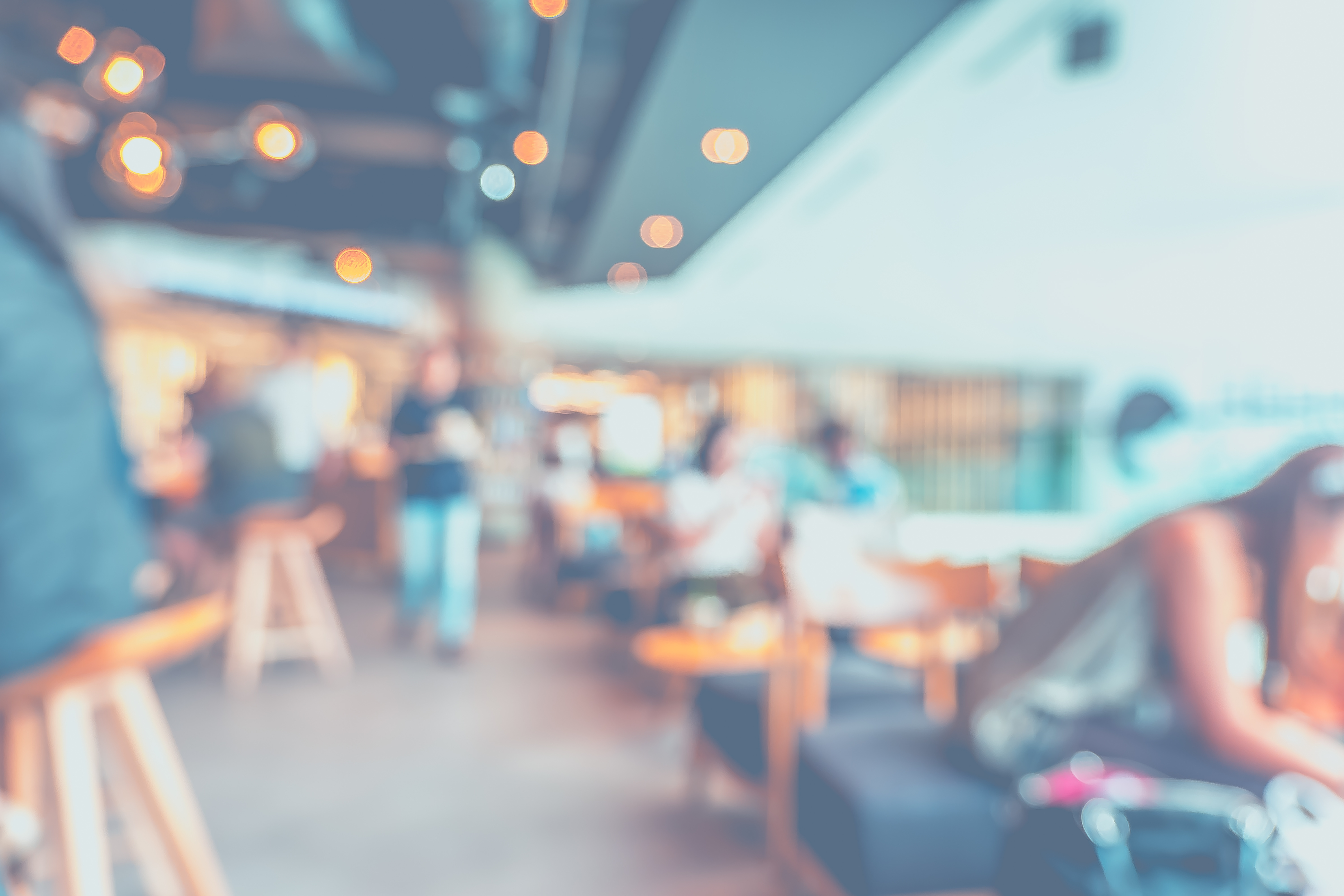 Blurred background of customer sitting in coffee shop or cafe restaurant with bokeh light..